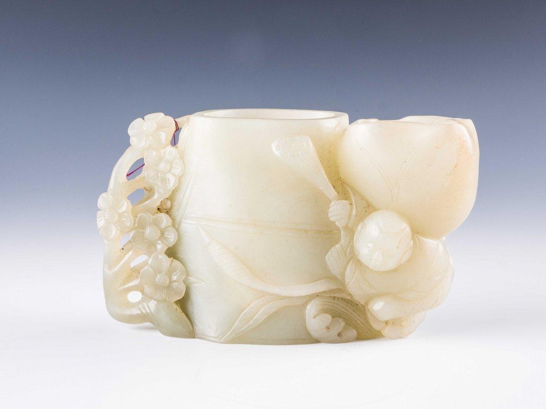 A white jade brushpot