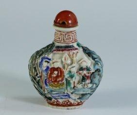 A Famille Rose Molded Porcelain Snuff Bottle