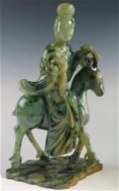A fine carved mottled green jadeite Guanyin