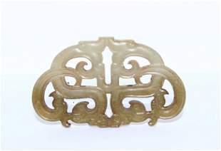 A corved jade pendant