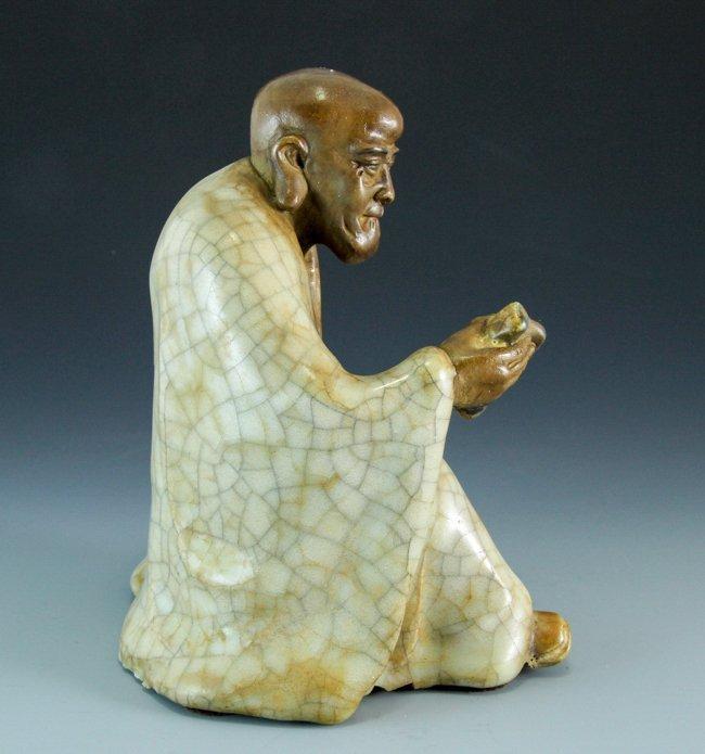 A Porcelain Figure Reading Arhat - 2