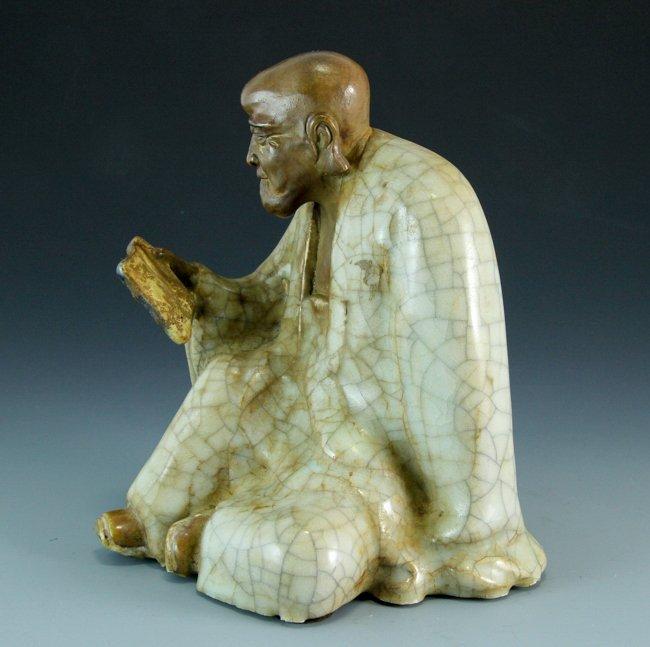 A Porcelain Figure Reading Arhat - 4