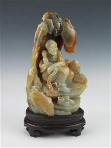 A white and russet jade 'arhat' boulder