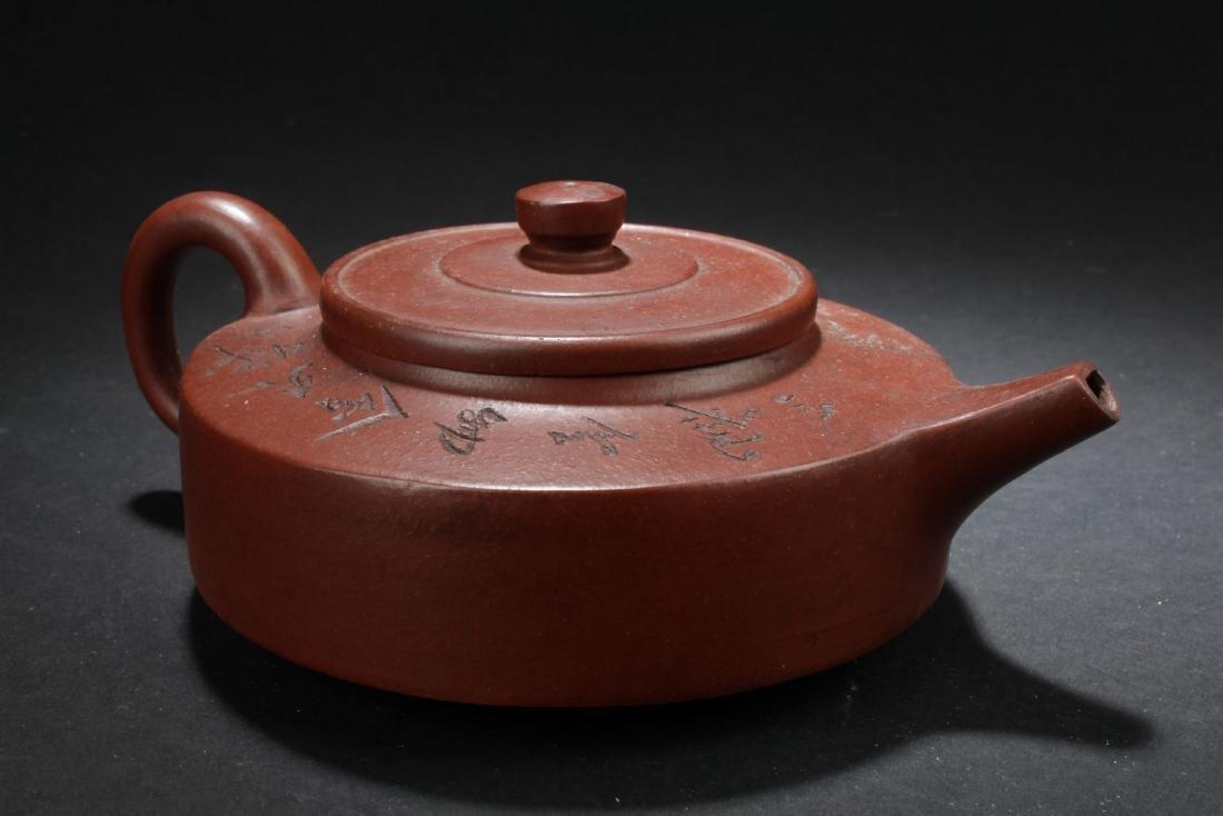 A Flat-circular Chinese Estate Tea Pot