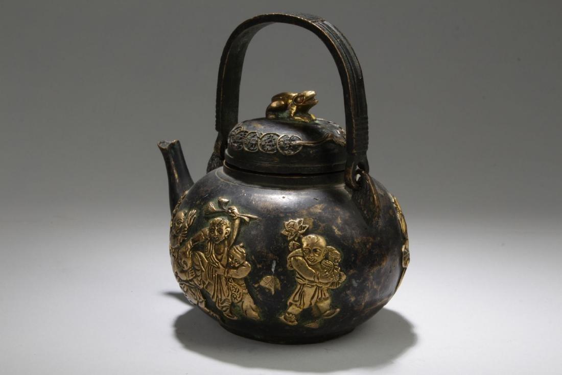 An Handled Chinese Bronze Tea Pot