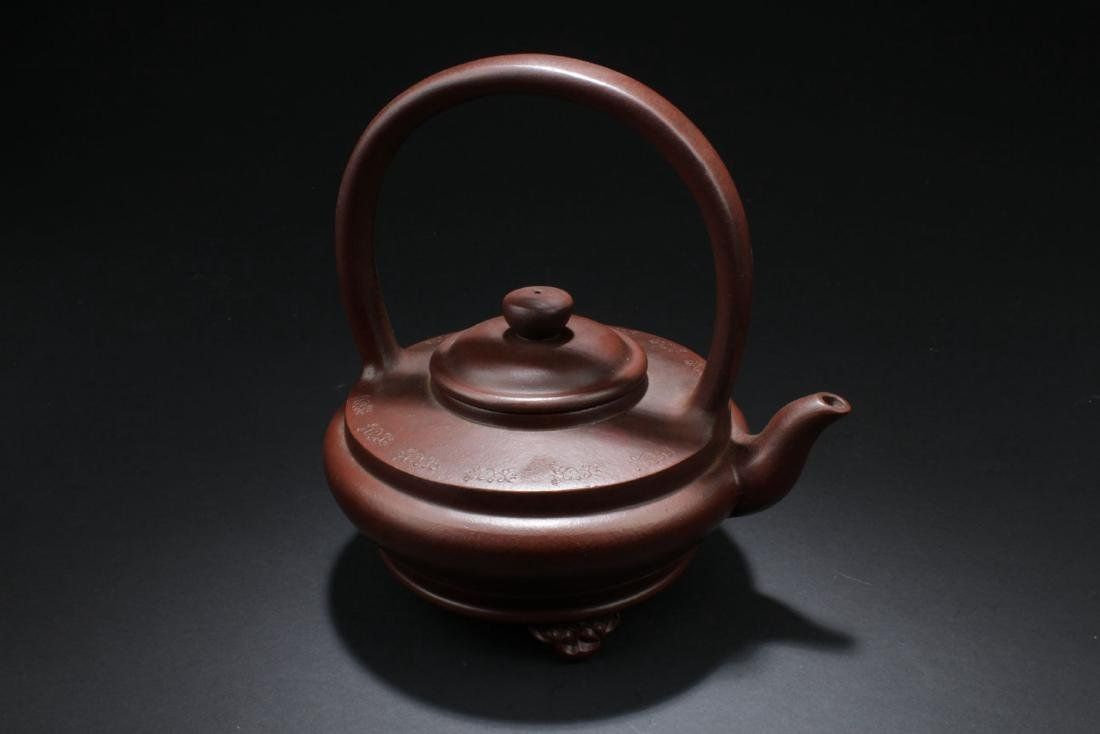 A Handled Round Chinese Tea Pot