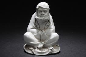 A Pondering-seated Chinese Porcelain Buddha Statue