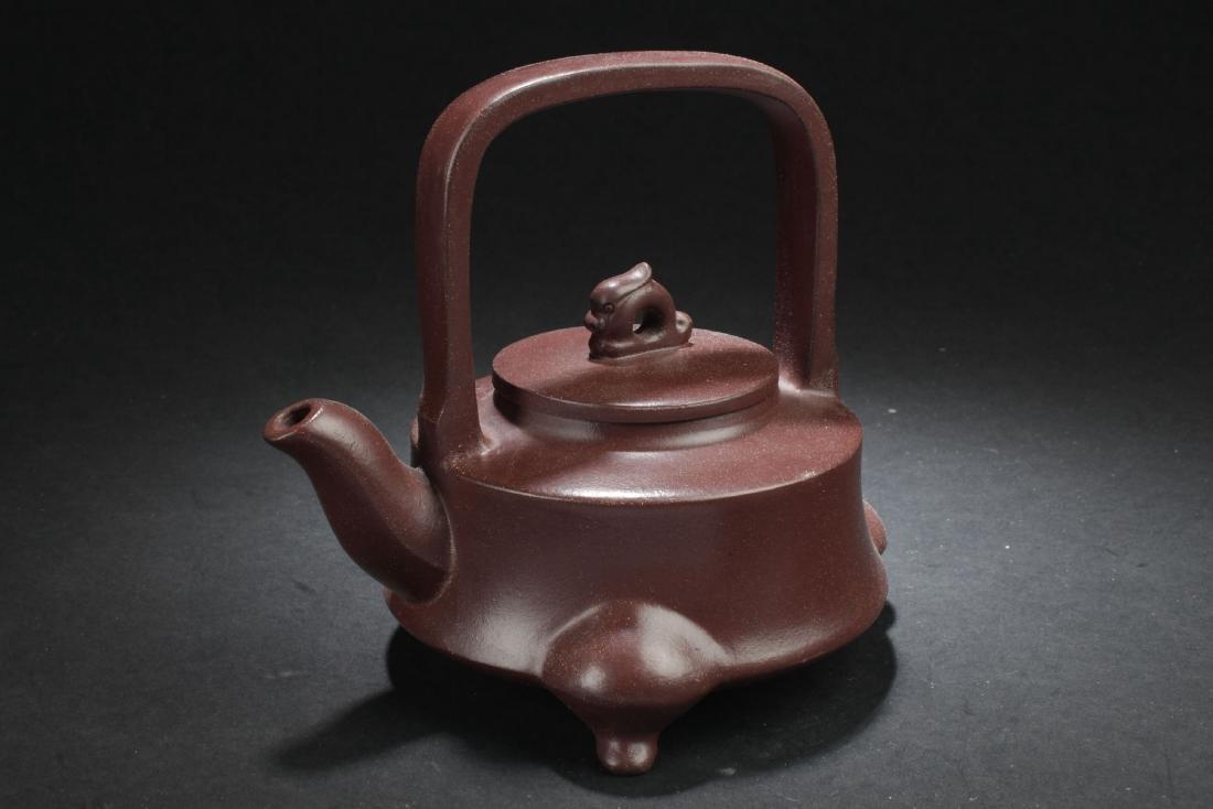 A Tri-podded Chinese Myth-beast Estate Tea Pot