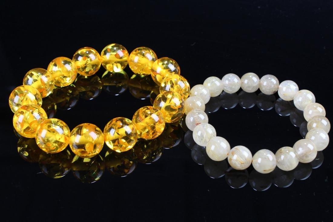 A Chinese Display-amber Estate Bracelet Display