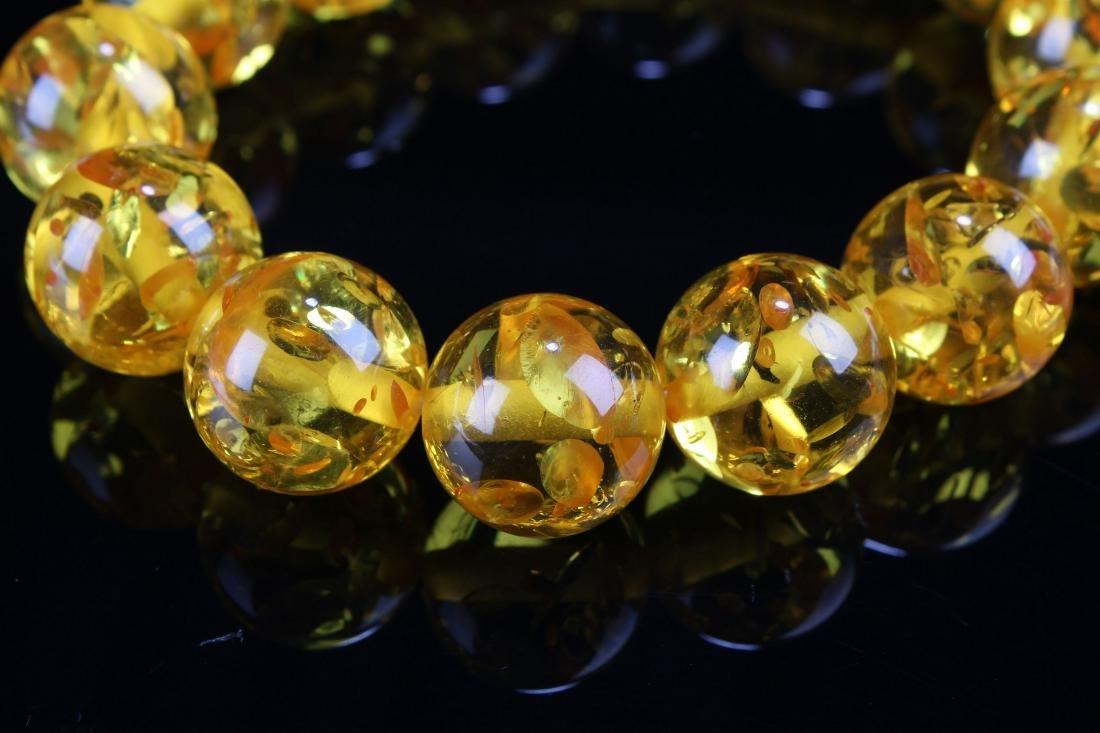 A Chinese Display-amber Estate Bracelet Display - 2