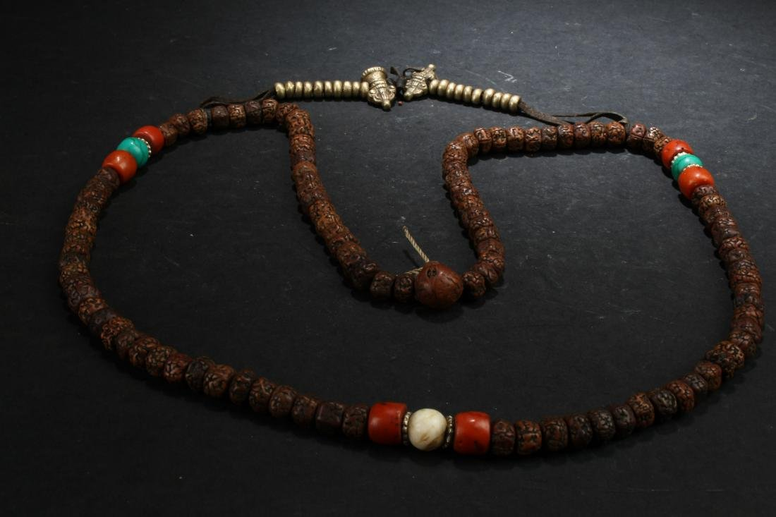 A Tibetan Estate Beaded Fortune Necklace Display