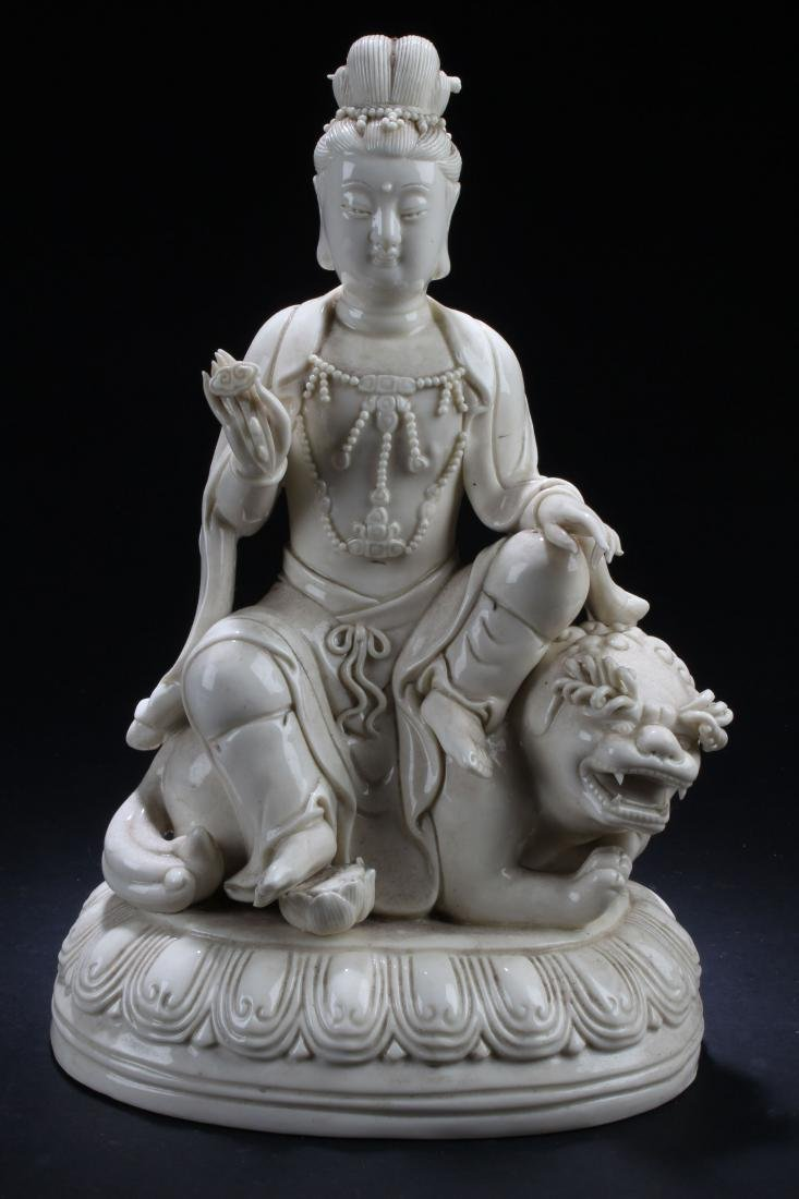 A Chinese Seated Estate Guanyin Porcelain Statue