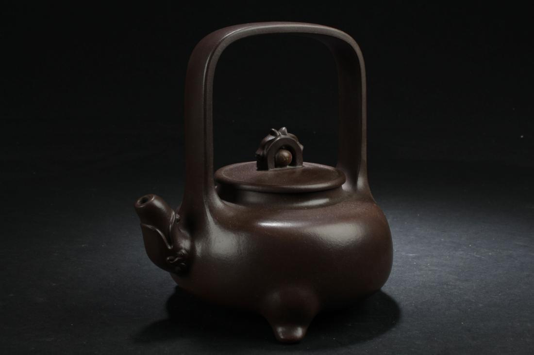 A Tall-handled Tri-podded Estate Tea Pot Display