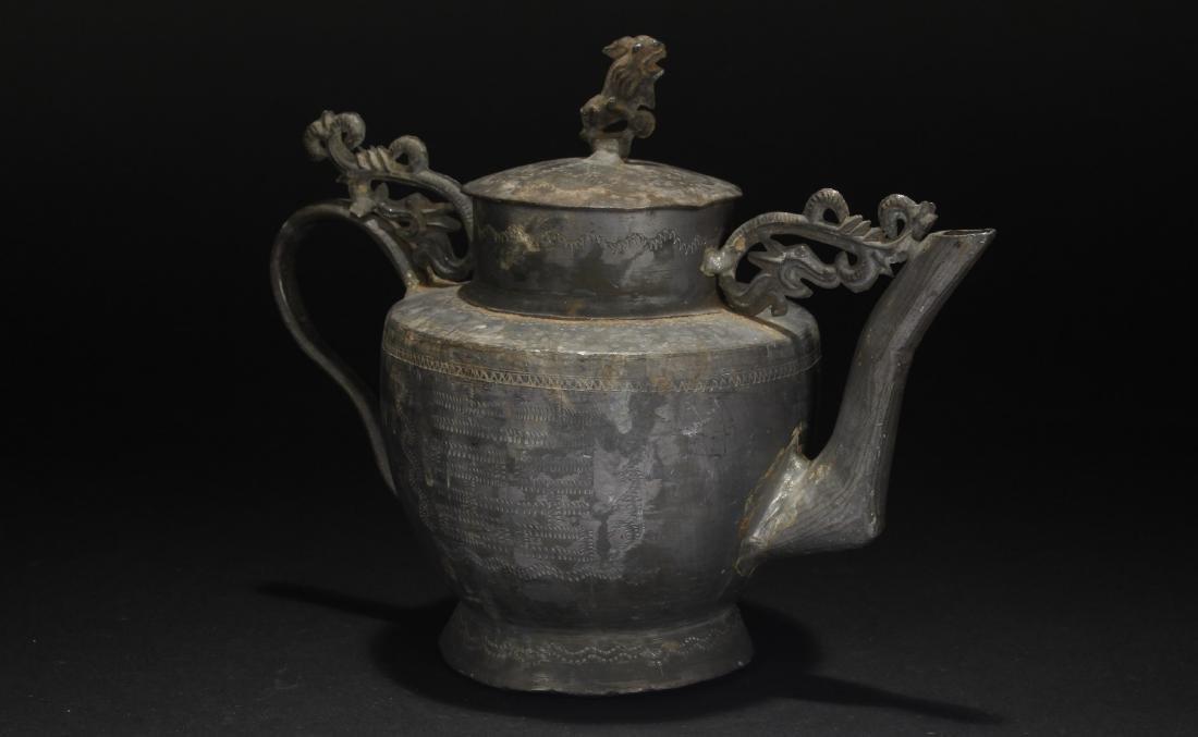 A Lidded Chinese Metal Tea Pot