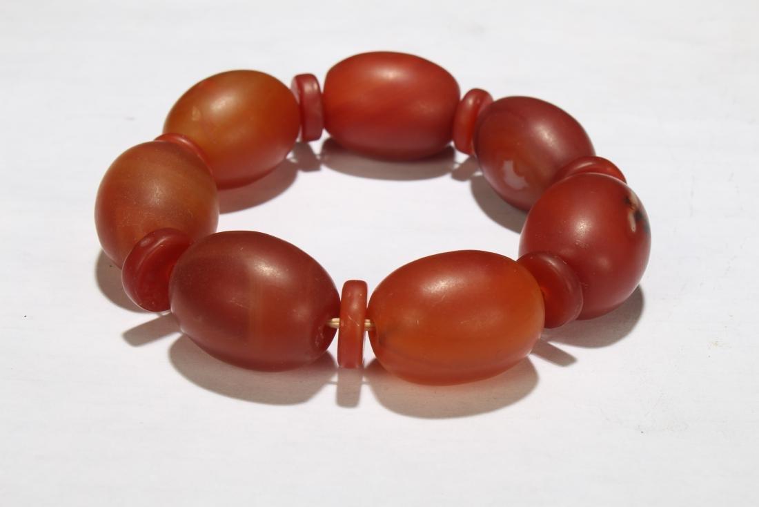 A Chinese Orange Beaded Bracelet