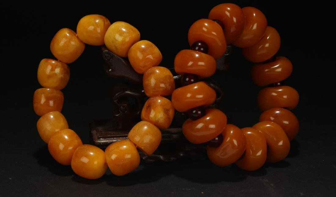 Two Chinese Orange Beaded Bracelets