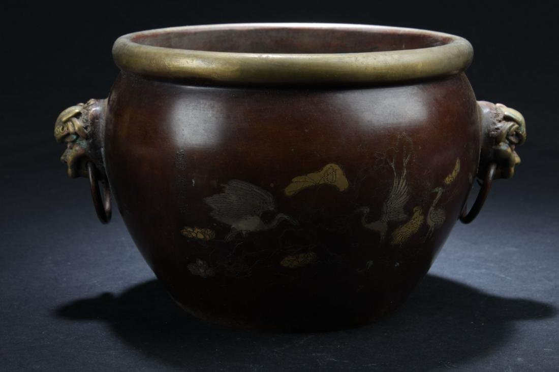 A Duo-handled Chinese Myth-beast Estate Censer Display