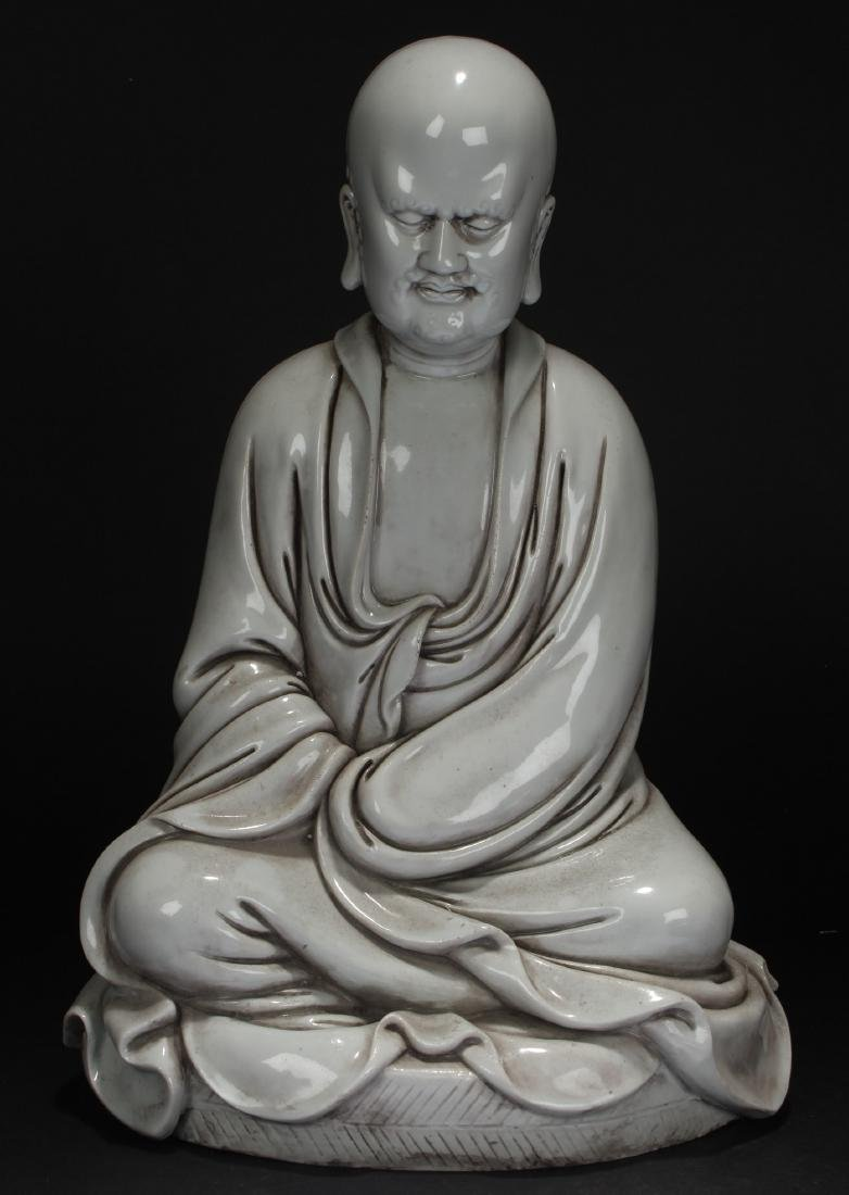 A Chinese Pondering-pose Estate White Porcelain Statue