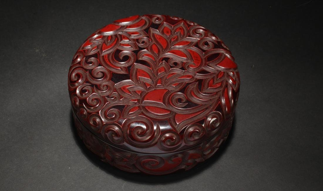 A Chinese Lidded Plant-filled fortune Lidded Lacquer