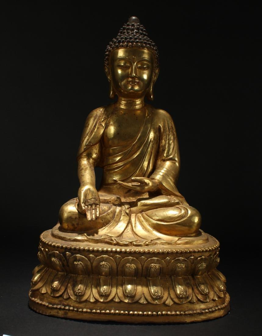 A Chinese Tall-base Loctus-seated Gilt Buddha Statue