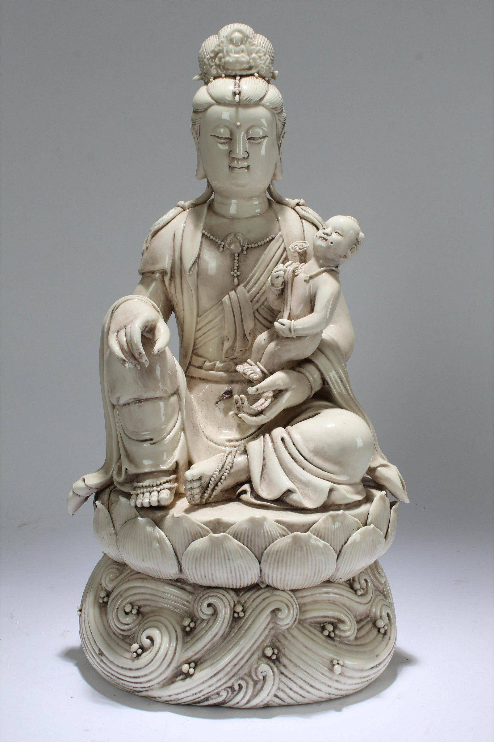 An Estate Chinese Joyful-kid De Blac Porcelain Guanyin