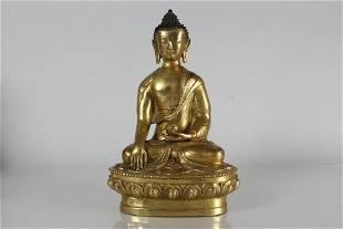 A Chinese Gilt Fortune Buddha Statue