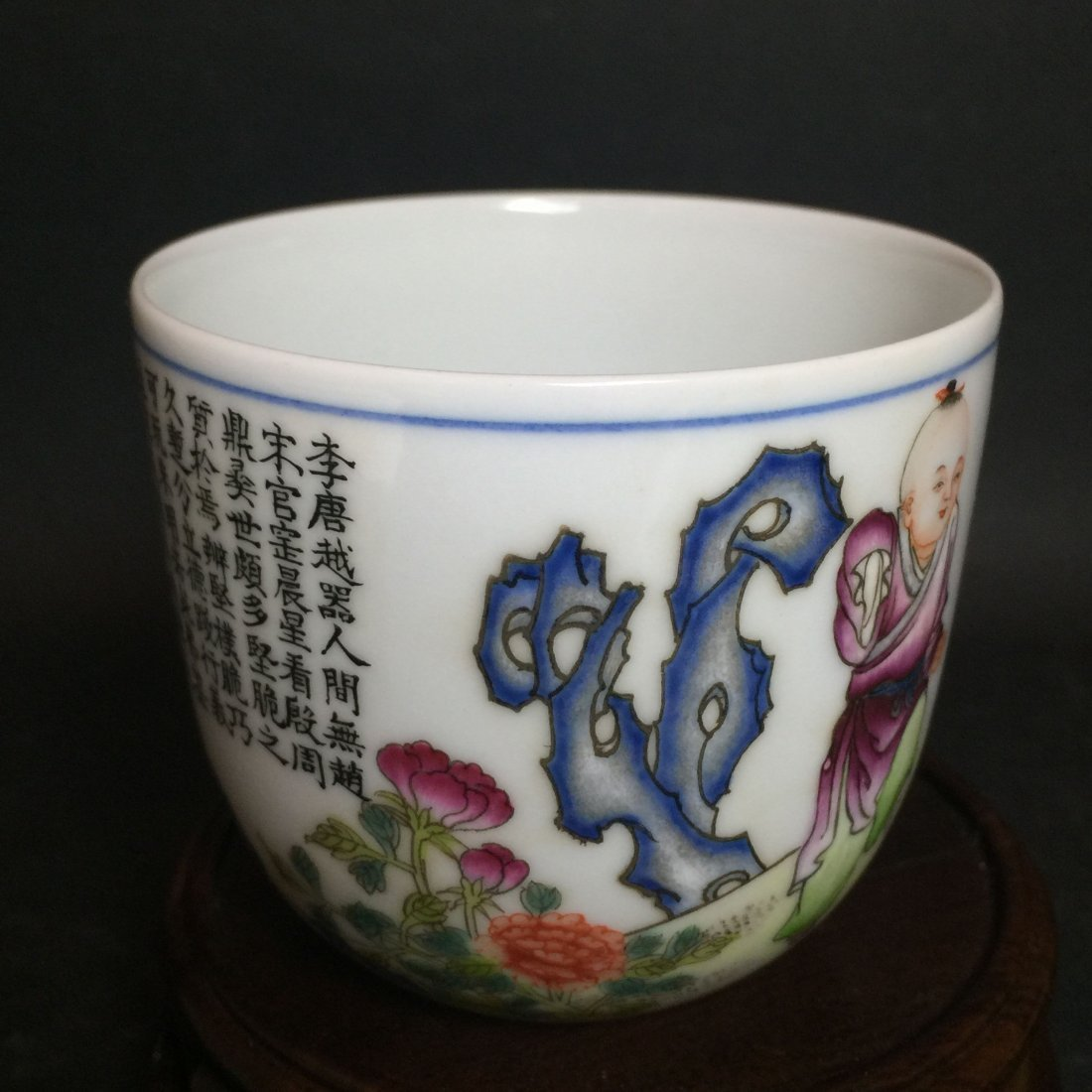 A White Porcelain Kid and Rooster Cup