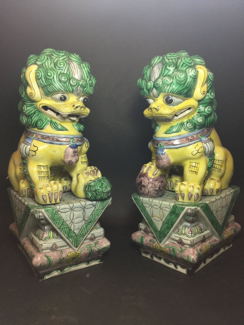 A Pair of Chinese Myth-lion Statues with Stands