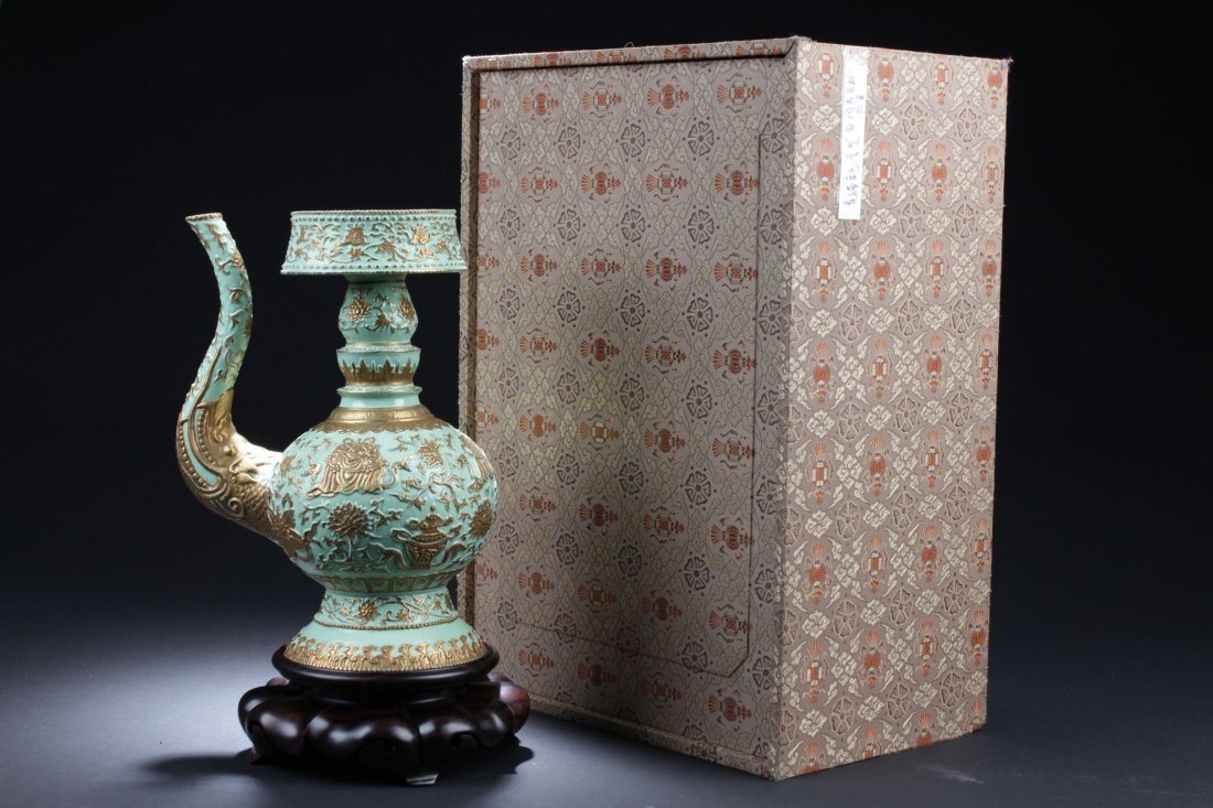 A Chinese Ewer-shape Porcelain Vase with Stand