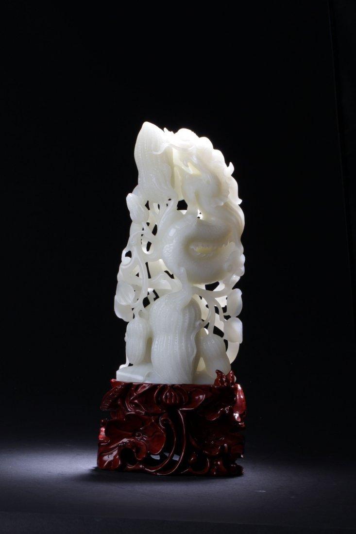 A Chinese Hotan Dragon Curving Display