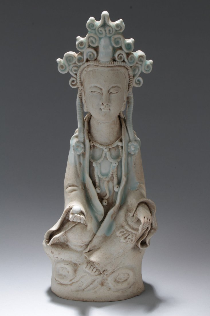 A Chinese Porcelain Buddha Statue