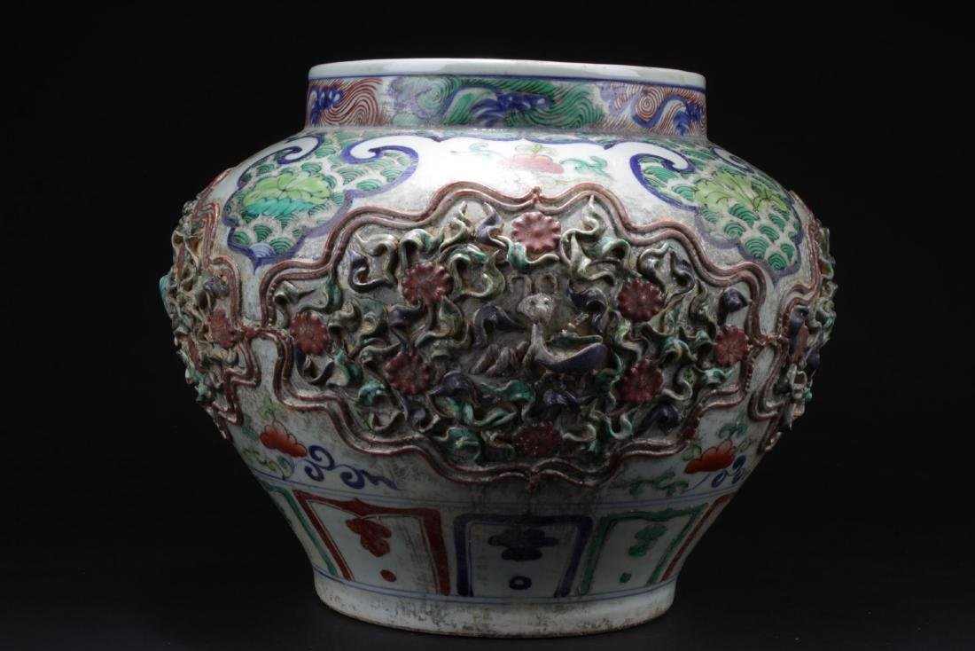 A Chinese Plant-filled Framing Porcelain Vase