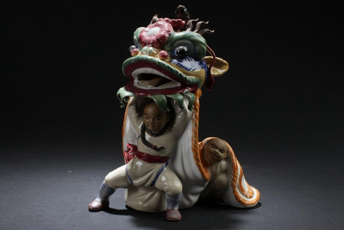 An Estate Porcelain Performing-sceen Statue