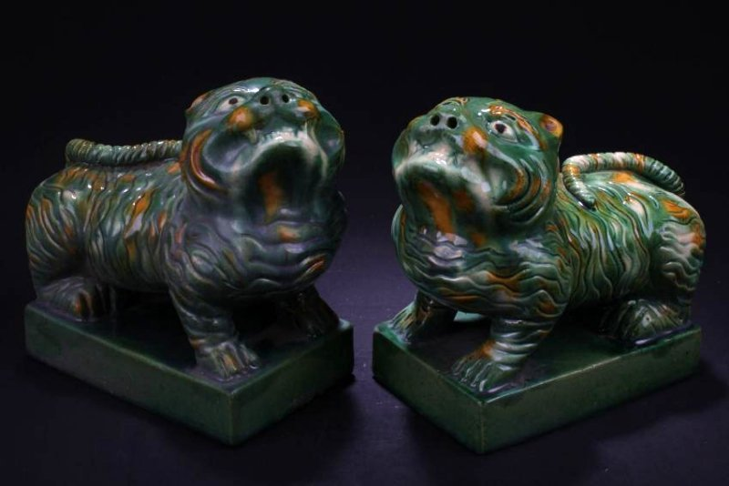 A Pair of Chinese Porcelain Beast Statues