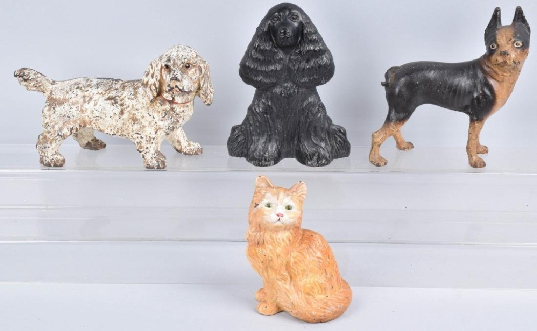 4-CAST IRON DOORSTOPS, A CAT and 3 DOGS