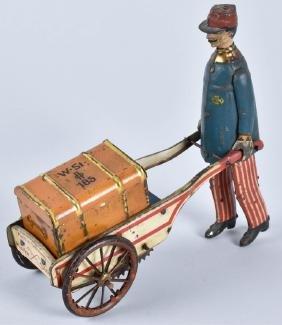 STOCK Tin Windup PORTER WITH LUGGAGE CART