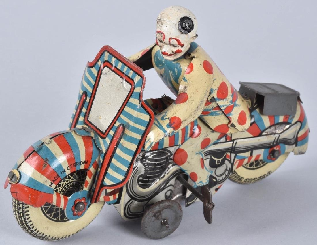 BRITAIN Tin Windup 1st PRIZE CLOWN ON MOTORCYCLE