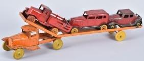 1930'S WYANDOTTE AUTO HAULER & 3 AUTOS