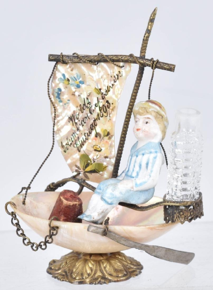 1893 COLUMBIAN EXPO BISQUE FIGURE IN BOAT PERFUME