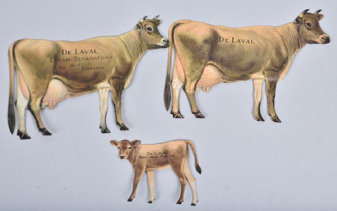 5-DELAVAL TIN ADVERTISING COWS - 2
