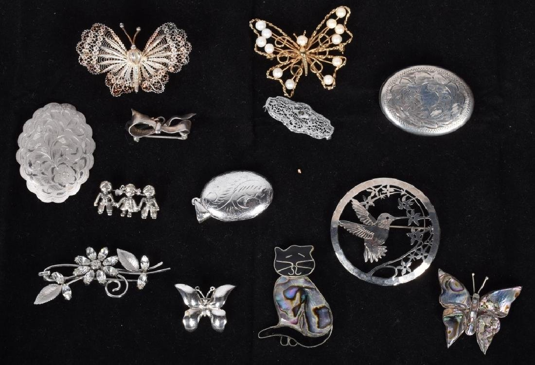 13 VINTAGE STERLING BROOCHES AND LOCKETS