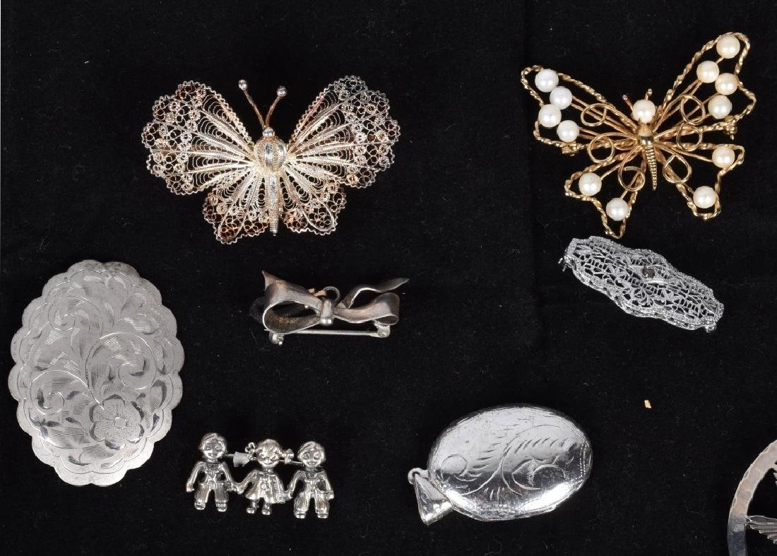 13 VINTAGE STERLING BROOCHES AND LOCKETS - 3