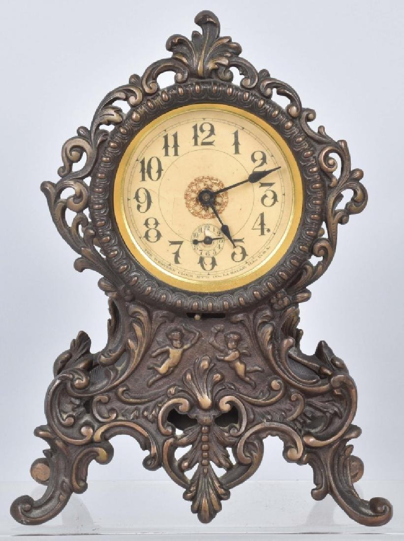 VINTAGE CAST IRON SHELF CLOCK