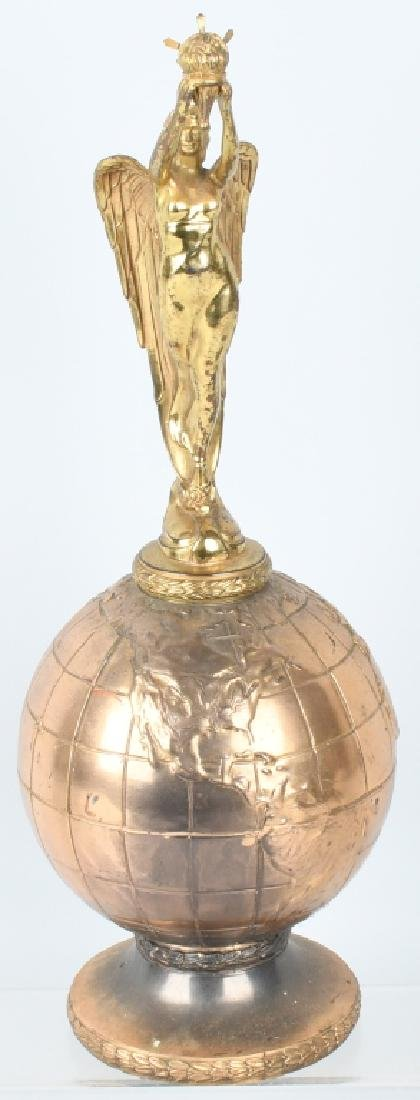 EARLY WINGED GODDESS ON GLOBE TROPHY
