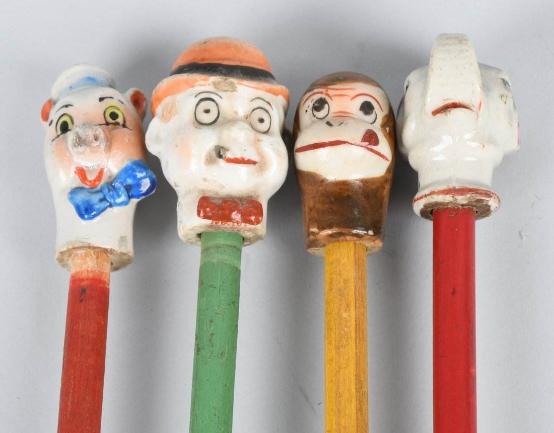 4- EARLY BISQUE HEAD CHARACTER CANES