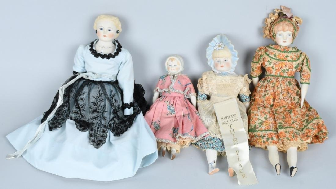 FOUR BISQUE SHOULDER HEAD DOLLS
