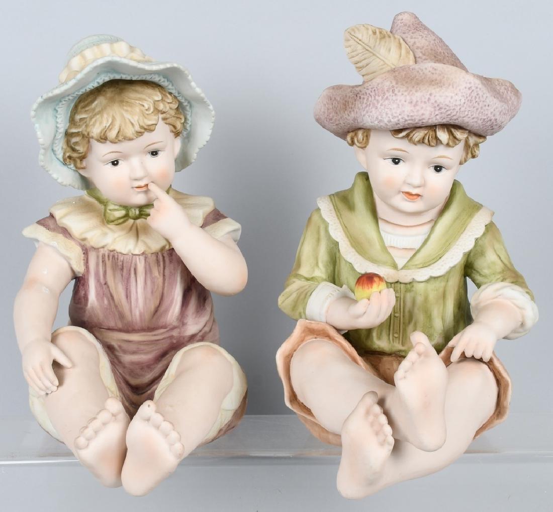 2-LARGE HUEBACH BISQUE PIANO BABIES