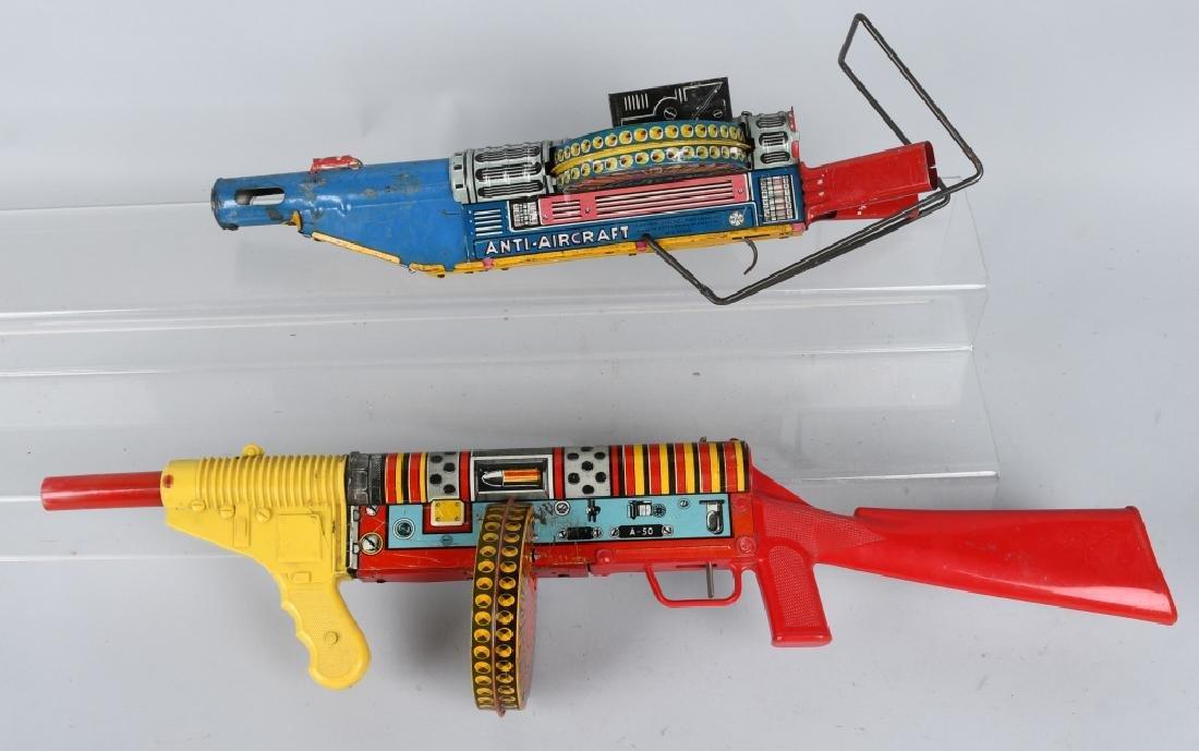 2- MARX TIN WINDUP GUNS