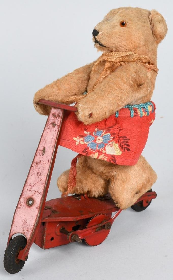 GERMAN WINDUP BEAR ON SCOOTER