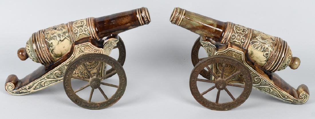 PAIR MAJOLICA STYLE CERAMIC CANNONS, BRASS WHEELS